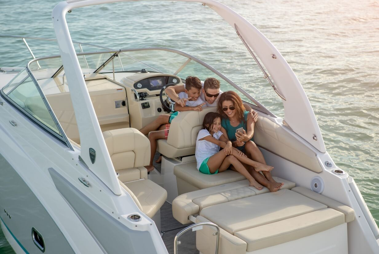 Family picture on board the Regal 26 Express on the aft sunbathing area